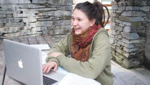 Laptop working in courtyard
