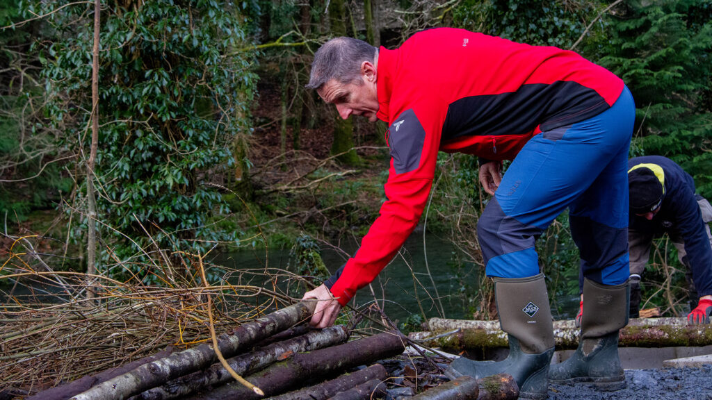 Iolo Williams helps build otter holt
